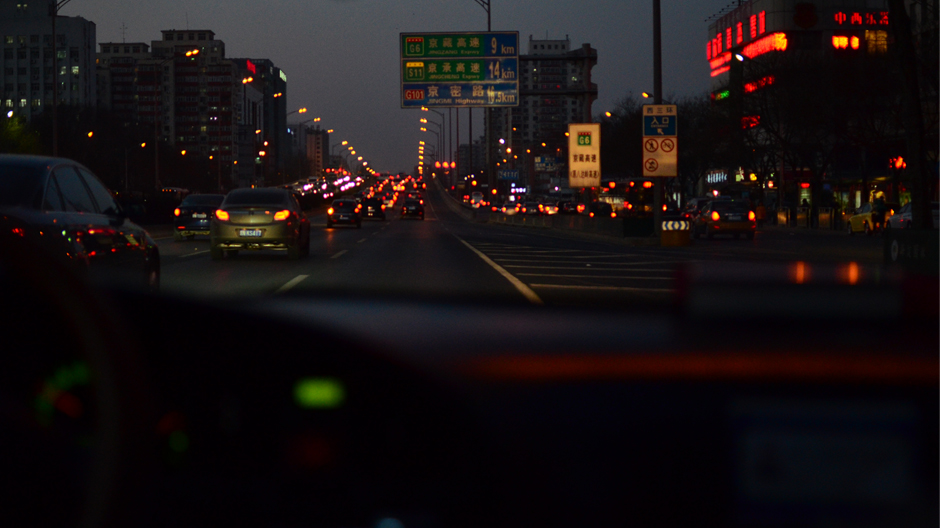Driving through Beijing by night.
